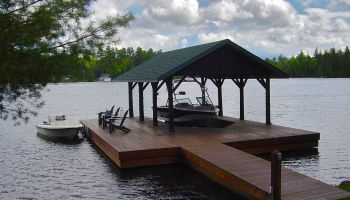 Note that owner's boat remains in covered slip.  Guests can tie a boat up to the dock.