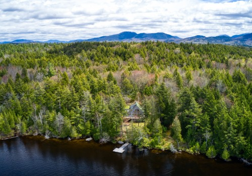 aerial view of Upper Saranac Lake and property