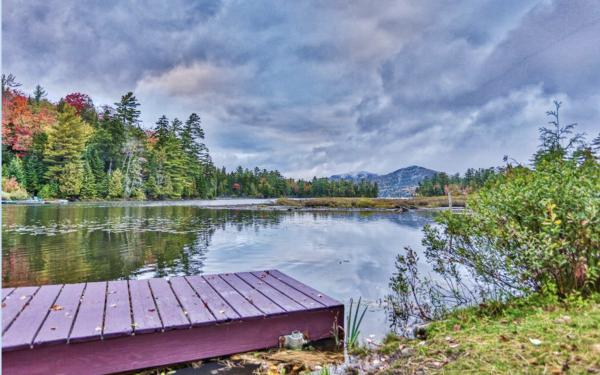 Paradox Lodge dock extending into Paradox Bay on Lake Placid